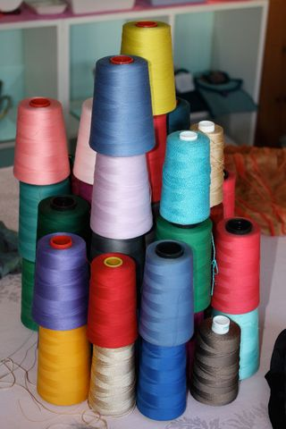 Thread-spools-stacked-color-sewing